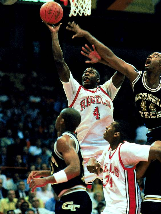 """Investigators made 11 visits to the campus -- looking into charges of academic irregularities and recruiting violations -- in the nine months prior to the Rebels destroying Duke 103-73 in the title game. It was the biggest blowout in the history of the championship game. UNLV star Larry Johnson finished with 22 points, 11 rebounds and four steals in the final. """"We want to win this championship bad,"""" Johnson said the day before the final, """"so that the NCAA guys will have to stare at that trophy on Coach's desk while they ask all those questions during the next investigation."""""""