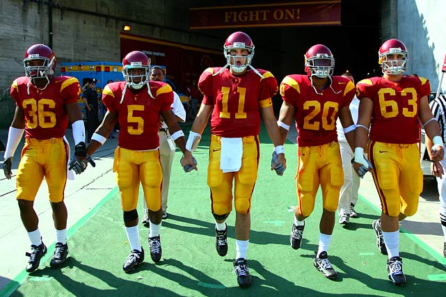 """Many came to resent the """"Hollywood"""" aspect of the Trojans -- quarterback Matt Leinart partying with Paris Hilton; celeb-fans Will Ferrell and Snoop Dogg hanging out at practices. Fans of other conferences bemoaned the Trojans' purportedly inferior Pac-10 competition. They cried foul over the """"Bush Push"""" that helped USC pull off a last-second win at Notre Dame. To many, though, the run-up to the Trojans' BCS title game against Texas served as a nauseating apex, with ESPN's analysts debating how the '05 USC team would fare against some of the greatest teams of all time. Vince Young and the Longhorns rendered the argument moot, but the public's animosity lingered for years due mostly to the NCAA's prolonged silence over allegations that Bush took money from potential marketing reps during his time there. That silence was broken in June 2010, and you know how the story ended."""