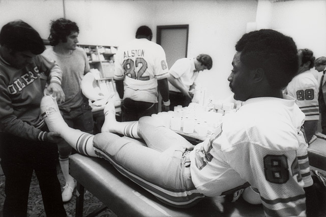 "Billy ""White Shoes"" Johnson gets his shoes taped before the Oilers' game against the Raiders. Johnson had three receptions for 37 yards."