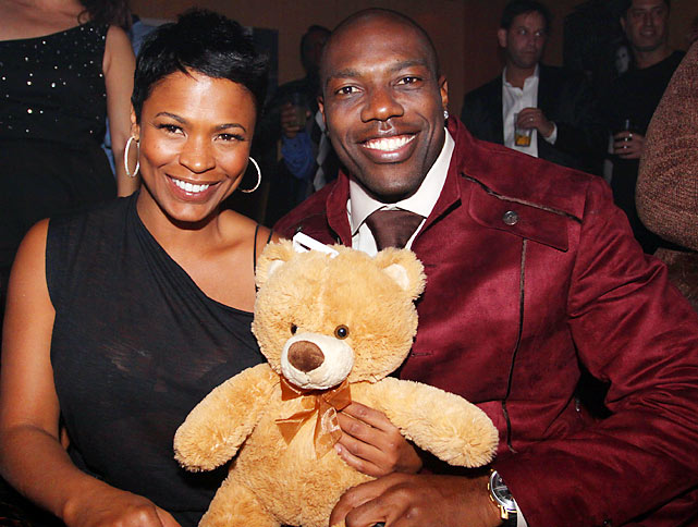 Nia Long sits with T.O. and Ted. E. Bear at Owens' birthday party at M2 Ultra Lounge in 2009 in NYC.