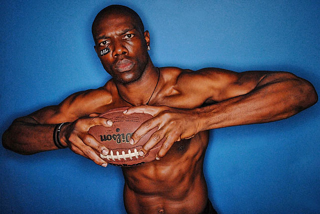 T.O. putting the results of all those driveway sit-ups on display during a 2010 photo shoot.