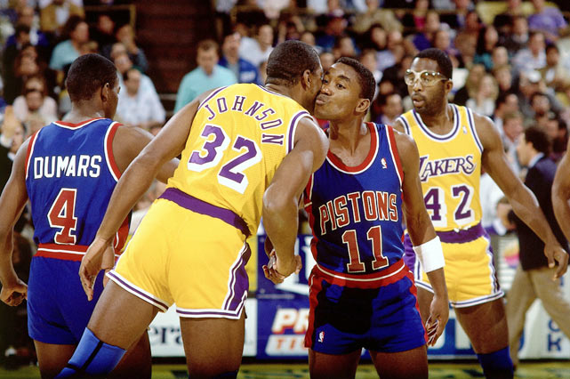 Longtime friends Magic Johnson and Isiah Thomas embrace prior to the start of the NBA Finals.