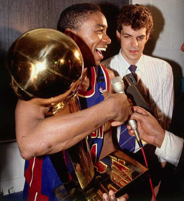 Thomas celebrates with the Larry O'Brien trophy.