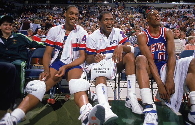 Rick Mahorn and Dennis Rodman sandwich Mark Aguirre as the Pistons close out Milwaukee in the Eastern Conference semifinals. Aguirre, who was selected No. 1 ahead of Isiah Thomas in the 1981 draft, gave the Pistons another offensive weapon when he was acquired midway through the season.