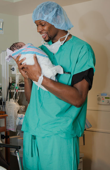 Chris Bosh holds his new son, Jackson, at a hospital in Miami. Bosh flew to south Florida for the birth of his son but made it back to New York for Game 3 of the Heat-Knicks first-round series.