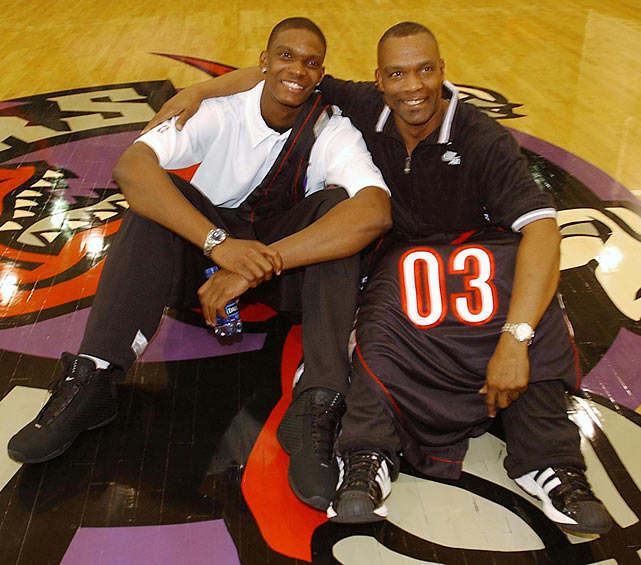 Noel Bosh poses with his son after the Raptors chose Chris with the fourth  overall pick in the NBA draft.