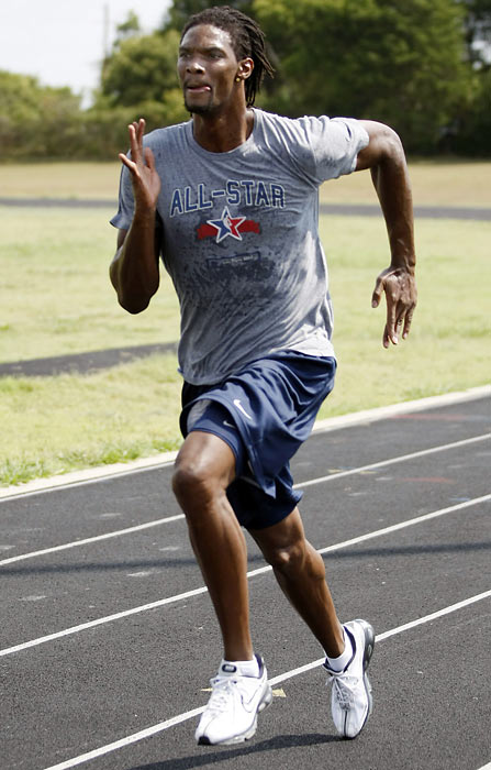 Bosh works out at the DeSoto High School track in DeSoto, Texas before the 2008-09 season.