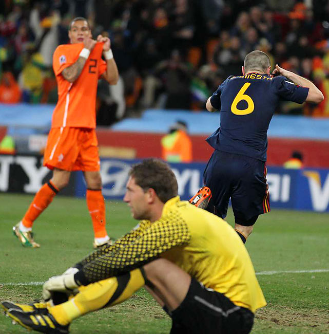 Dutch goalkeeper Maarten Stekelenburg and defender Gregory Van Der Wiel react to Andres Iniesta's goal. The Dutch defense, questioned before the World Cup, did well to keep Spain scoreless as long as it did.