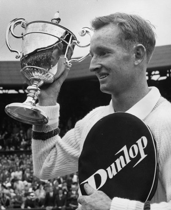At Wimbledon, Rod Laver wins the championship after beating Martin Mulligan in straight sets (6-2, 6-2, 6-1).