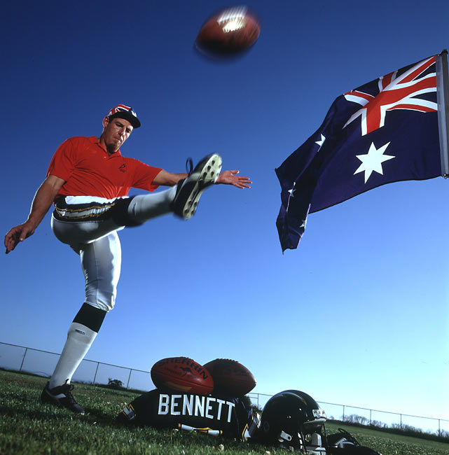 Chargers punter Darren Bennett works on his craft next to a flag of his native Australia.