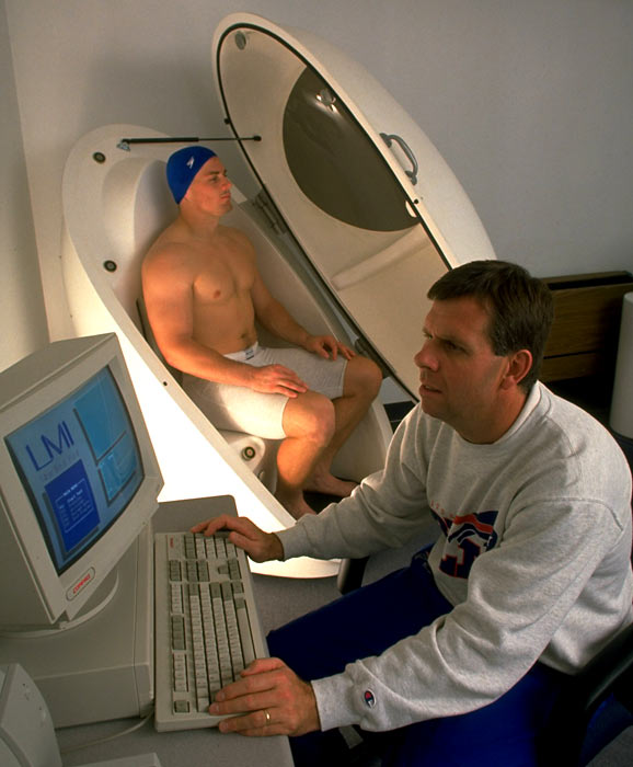Bills LB John Holecek sits in The Bod Pod, which measures body fat, as strength and conditioning coordinator Rusty Jones reads the results.