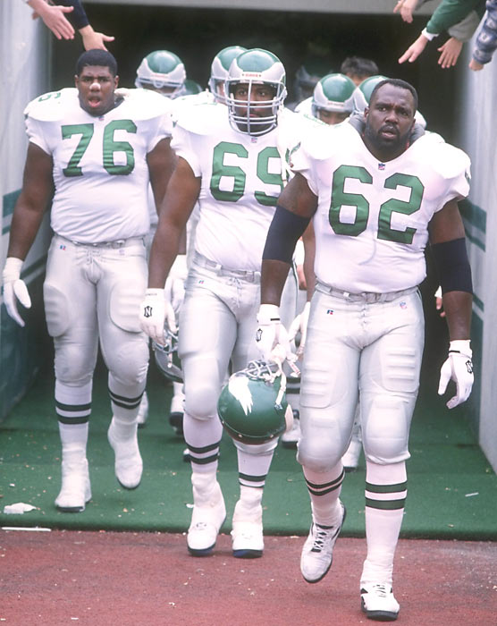 Eagles' defenders Barrett Brooks (76), Harry Boatswain (69) and Guy McIntyre (62) walk onto the field before a game against the Cowboys.