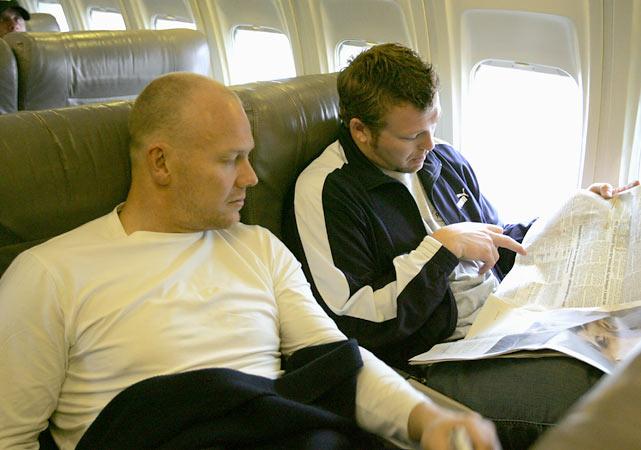 Mats Sundin (left) and Martin Brodeur of the Primus Worldstars read a newspaper en route to Bern, Switzerland.