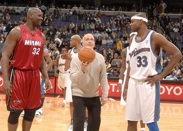 Ripken tosses the ceremonial jump ball as Shaquille O'Neal and Brendan Haywood look on during the Heats-Wizards game in Washington DC.