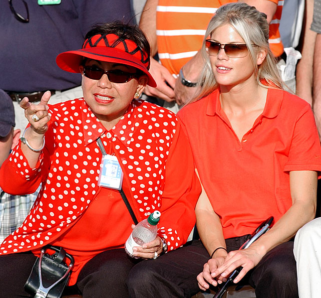 Elin sits with Tiger's mother, Kultida, at the Masters in 2002.