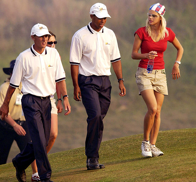 Elin, Tiger and Charles Howell III walk along the 18th fairway at the Presidents Cup in South Africa in November 2003.