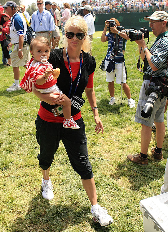 Elin walks the course with daughter Sam after Tiger won the playoff round of the 108th U.S. Open in June 2008.  It was Woods' third U.S. Open Championship and his 14th major title.