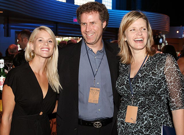 Elin poses with Will Ferrell and his wife, Viveca, at the Second Annual Tiger Woods Learning Center Block Party in October 2006.