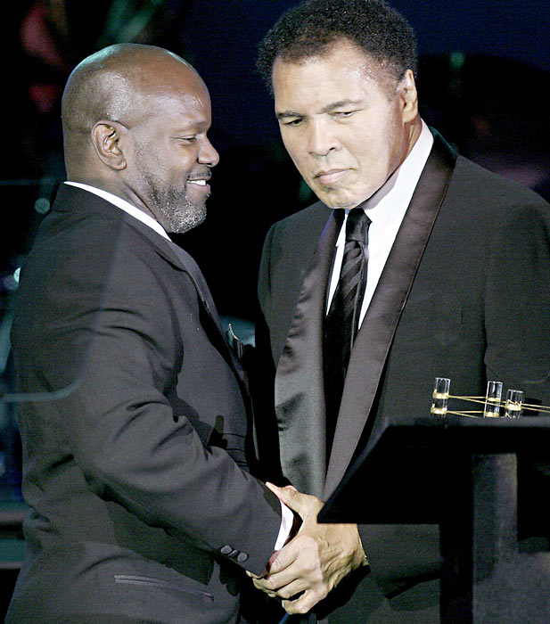 "Smith receives congratulations from Muhammad Ali after being awarded the ""Muhammad Ali Sports Achievement Award."""