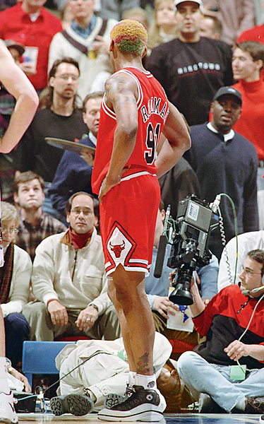 One major appeal of the NBA is the intimacy of the arena.  In no other sport can fans and media get as close to the action. But this proximity can come at a price, a lesson cameraman Eugene Amos found out the hard way.  Amos was working on the baseline at a Minnesota Timberwolves game when Dennis Rodman stumbled into the crowd and twisted his ankle on Amos' camera.  Angered, Rodman kicked Amos in the groin.  The incident cost Rodman $1.2 million, including a $200,000 payout to Amos.