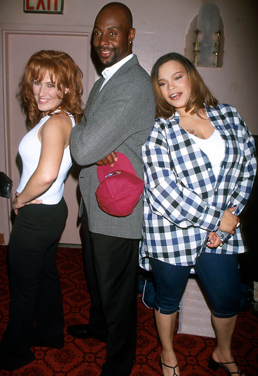 Three titans of their respective industries: Rice poses with singers Jo Dee Messina (left) and Faith Evans.