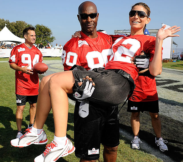 Get him to the Greek: Rice posed with Maria Menounos during the Madden NFL 10 Pigskin Pro-Am.