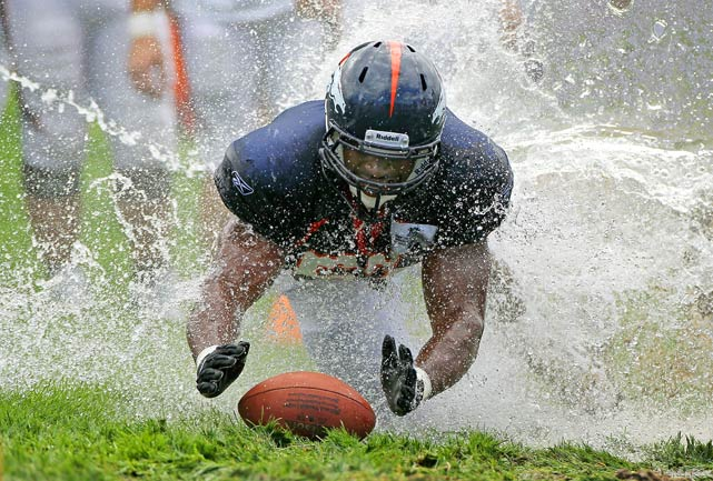 Linebacker Jammie Kirlew of the Denver Broncos dives for the ball as rookies partake in the slip and slide fumble drill during training camp at Dove Valley on Aug. 5 in Englewood, Colorado.