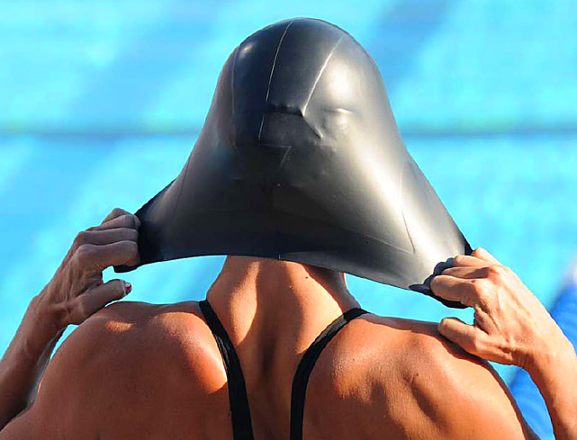 Natalie Coughlin adjusts and stretches her swimming cap into a Darth Vader like shape before competing in the 100 meter backstroke on Aug. 4 at the U.S. National Swimming Championships in Irvine, Calif. Coughlin won the event.