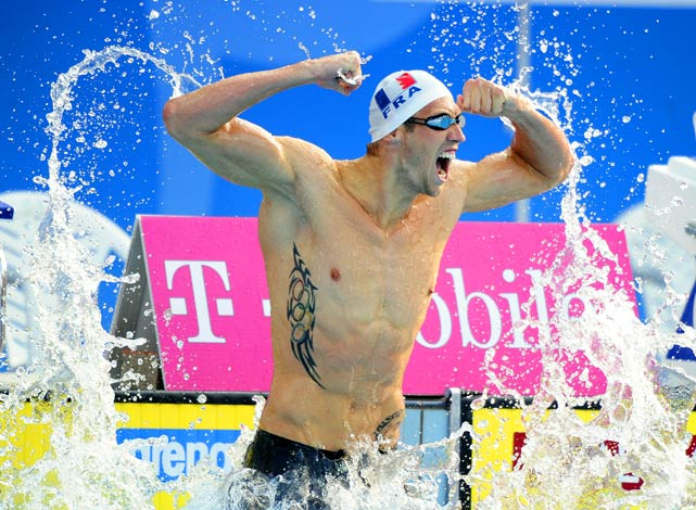 France's Alain Bernard celebrates after winning the 100m freestyle final at the European Swimming Championships in Budapest.