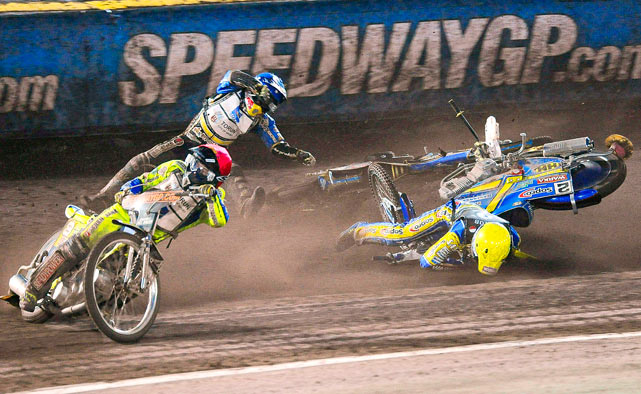 Emil Sayfutdinov of Russia, center, and Tomasz Gollob of Poland, right, take a spill behind Leigh Adams of Britain, left, during the FIM Speedway Grand Prix of Sweden on Aug. 14 in Malilla, Sweden.