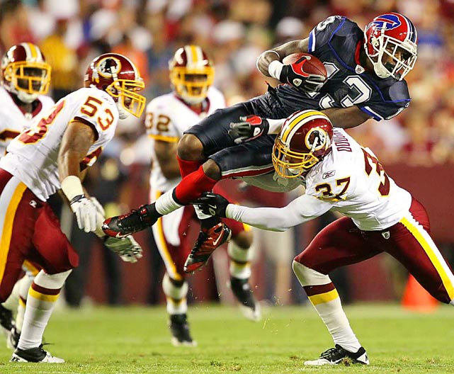 Buffalo Bills wide receiver Steve Johnson  is tackled by Washington Redskins safety Reed Doughty and linebacker Perry Riley during their preseason game Aug. 13 at FedEx Field in Landover, MD. The Redskins defeated the Bills 42-17.