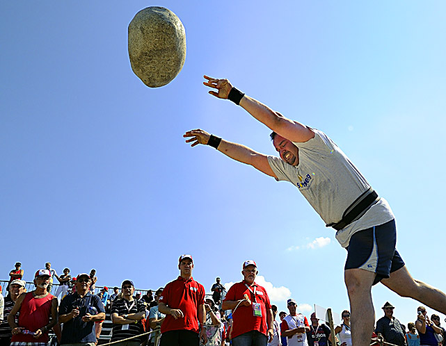 An athlete throws the 83.5kg Unspunnen stone during the Federal Alpine Wrestling Festival on Aug. 21 in Frauenfeld, Switzerland. More than 200,000 spectators attended the event, which takes place every three years.