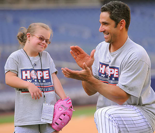 New York Yankees catcher Jorge Posada poses for a photograph with Hannah Santoru during Yankees HOPE week to honor The Beautiful People.