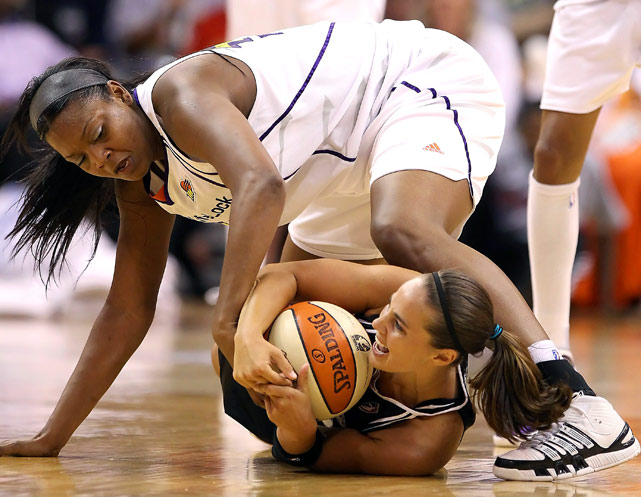 Kara Braxton of the Phoenix Mercury battles for a loose ball with  Becky Hammon of the San Antonio Silver Stars in Game 1 of the Western Conference semifinals Aug. 26 at US Airways Center in Phoenix.  The Mercury won 106-93.