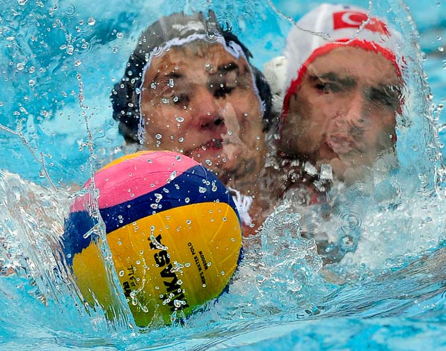 Andrei Busila (left) of Romania fights for the ball with Anil Sonmez of Turkey during their European water polo championships preliminary match Aug. 29 in Zagreb, Croatia. Romania won 12-6.