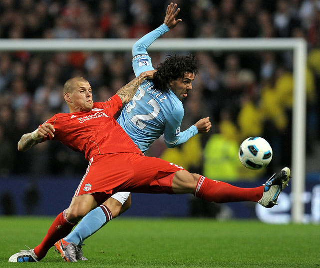 Liverpool defender Martin Skrtel vies with Manchester City forward Carlos Tevez during their English Premier League match Aug. 23.  Liverpool lost 3-0.
