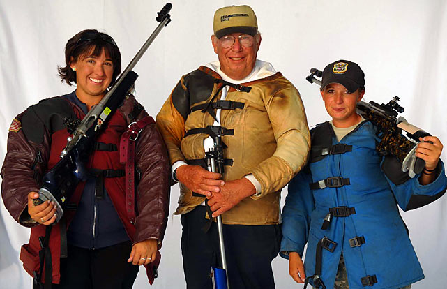 2009 winner Sherri Gallagher (right) and her fellow competitors (including sister Michelle, left) don shooting coats, which are padded in the elbows and shoulders to provide the shooters with maximum comfort.  Individuals often wear sweatshirts or sweaters underneath the jacket, which provides more cushioning and helps muffle their pulse.