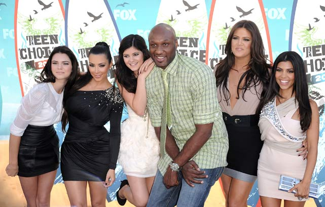 Meanwhile, Kobe's teammate, Lamar Odom, decided to stay behind and chill with the Kardashian sisters at the Teen Choice Awards in University City, Calif.