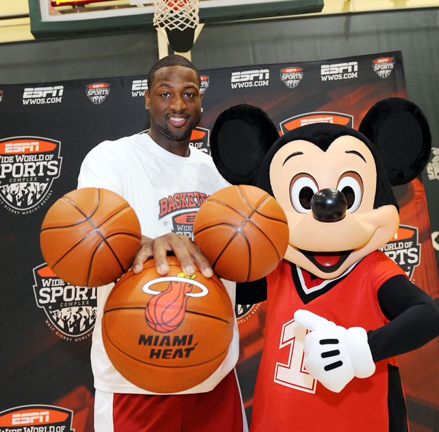 The free agent frenzy and upcoming FIBA World Championships didn't stop many NBA players from enjoying their time off the court. Here's a look at some of the league's biggest names as they toured the world this summer, starting with Dwyane Wade, who visited ESPN's Wide World of Sports complex in Disney World and was given hand-painted basketballs in the shape of Mickey Mouse's head.