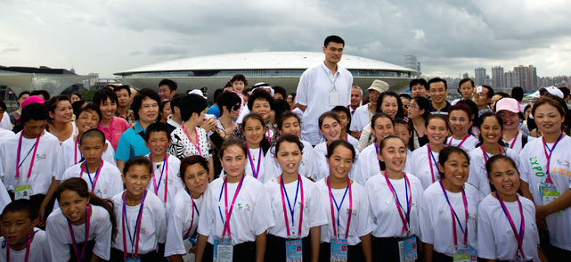 Rockets big man Yao Ming, who's still recovering from foot surgery, went home to China. He fit right in at the Saudi Pavilion at the World Expo Park in Shanghai.