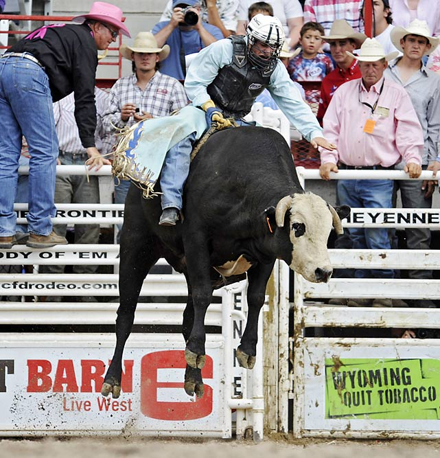 Bullrider Rorey Maier hangs on for dear life when his mount goes airborne.