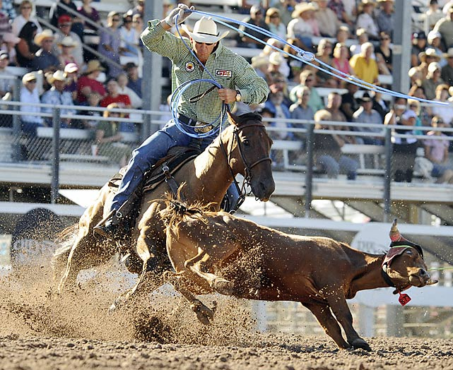 Rodeo is a team sport, too. Here, riders compete in team tie-down roping.