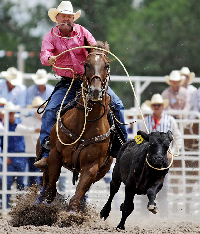Jeff Chapman, of Athens, Texas, participates in tie-down roping.