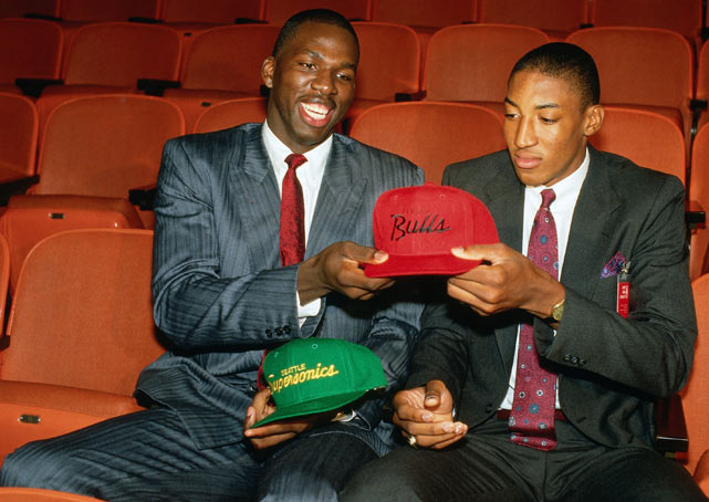 Future Hall of Famer Pippen and Polynice exchange hats after the 1987 NBA Draft. Pippen was taken fifth overall by Seattle and traded for Polynice, who was drafted eighth.
