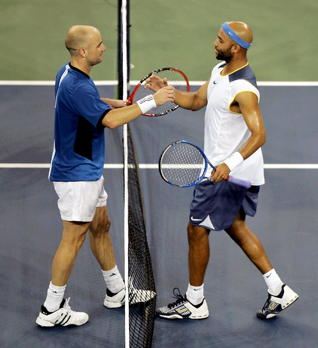 "In a quarterfinal match that starts at 10:16 p.m., Andre Agassi defeats James Blake 3-6, 3-6, 6-3, 6-3, 7-6(6). After the match during his live on-court interview, Agassi says, ""One-fifteen in the morning? 20,000 people still here. I wasn't the winner, tennis was."""