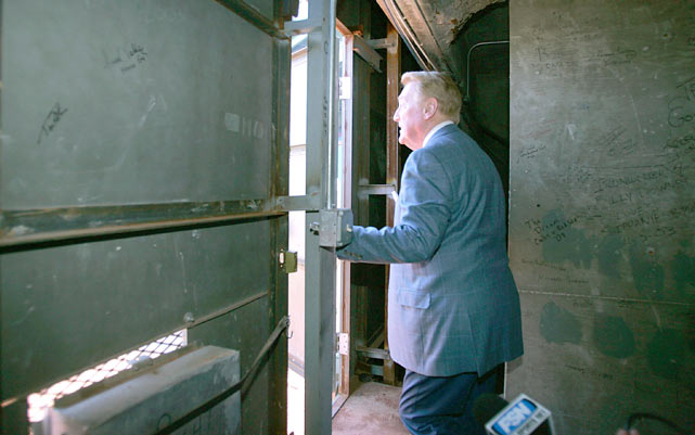 Scully stares out the door of the Green Monster at Fenway Park before a Dodgers-Red Sox game.