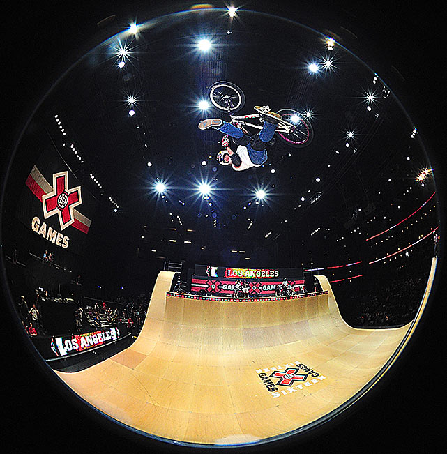 Kevin Robinson does a trick in the BMX vert.