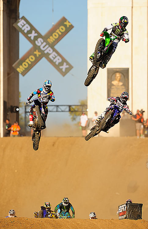 Riders come off the jump in the Moto X Super X.