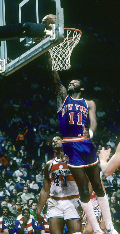 Though he lacked the sustained dominance that made figures such as Wilt Chamberlin and Kareem Abdul-Jabbar household names, for five years, Bob McAdoo might have been the most unstoppable force in the NBA. Though age eventually slowed McAdoo down, when he left the NBA for Europe his career was rejuvenated. Averaging 26.1 points and 10.2 rebounds, McAdoo led Olimpia Milano to the FIBA European Champions Cup twice, and he is considered one of the greatest U.S.-born players to ever play in Europe.