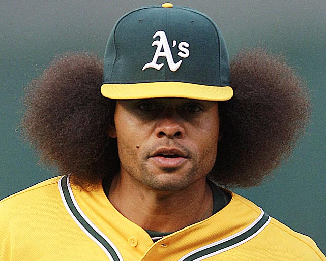 Coco Crisp couldn't get all of his afro under his hat during a game against the Tigers. Where does Crisp's hair rank among the best hairstyles in sports history? Judge for yourself.